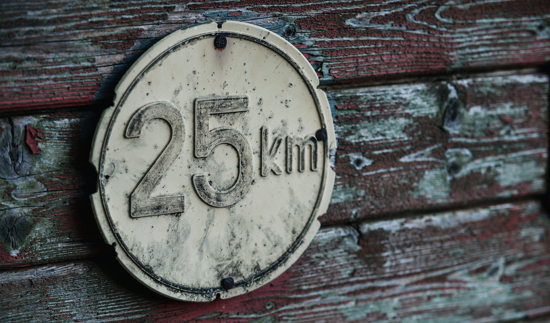 Round Gray 25 Km Signage