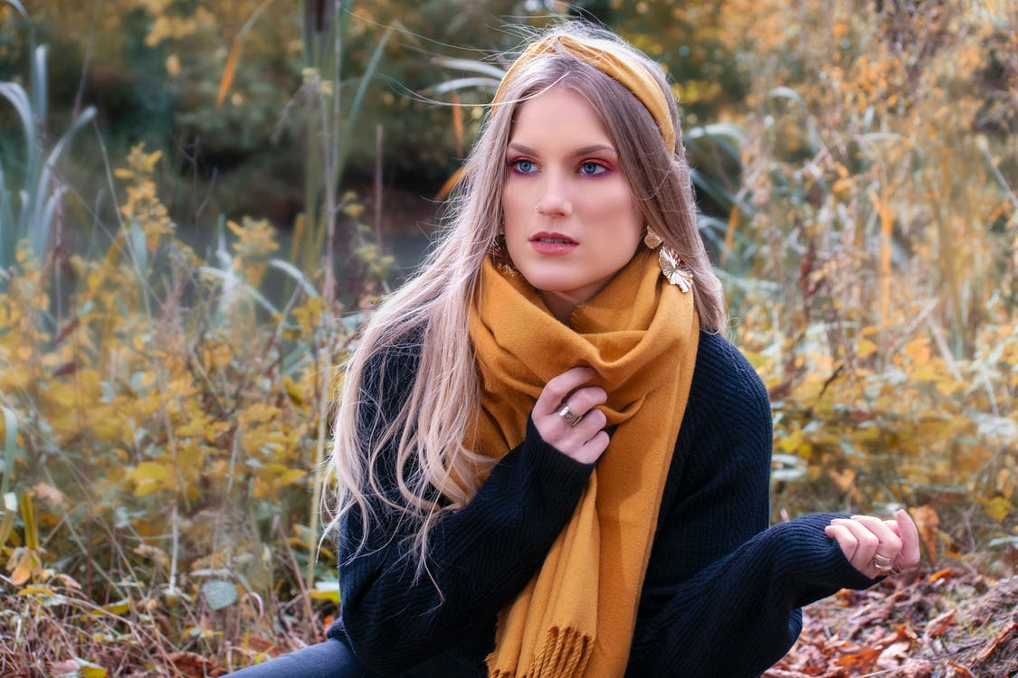 Woman in Black Sweater and Yellow Scarf