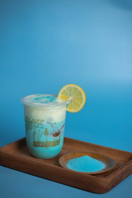 Refreshing cold blue mocktail garnished with lemon slice