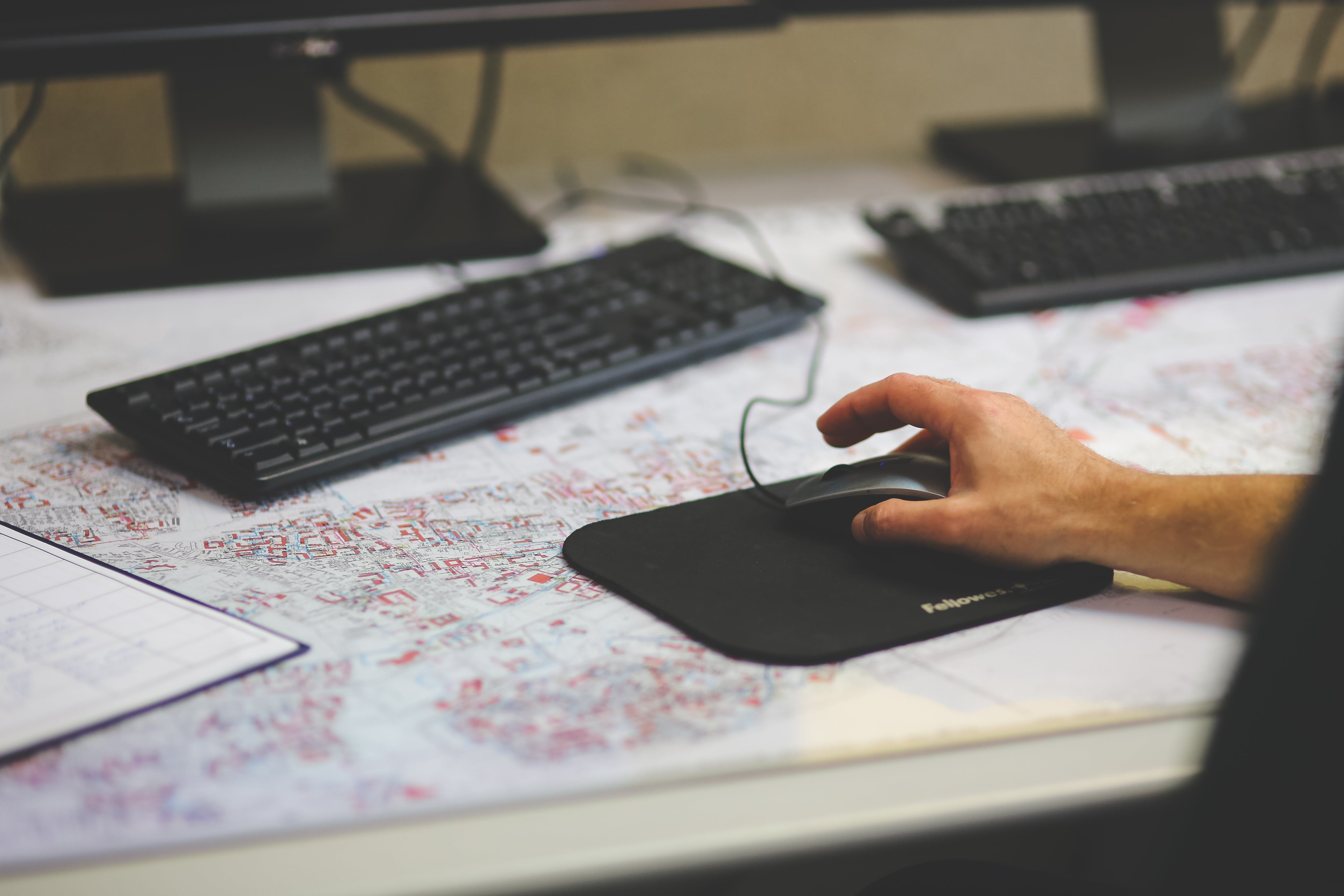 Men's hand on the computer mouse