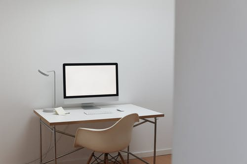 Modern workplace with computer and notepad