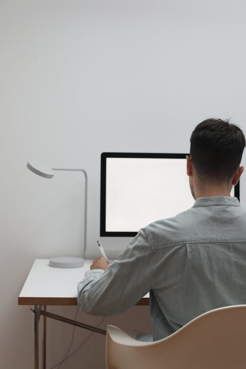 Anonymous man working in modern office