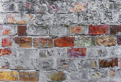 Brown and White Brick Wall