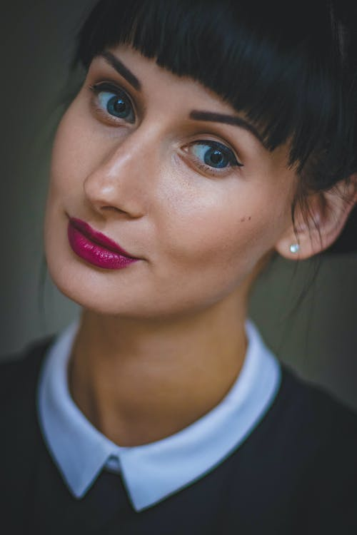 Woman Wearing Makeup and Collared Shirt