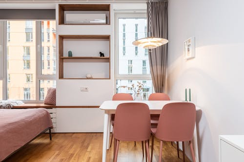Modern room with wooden shelves and chairs with table