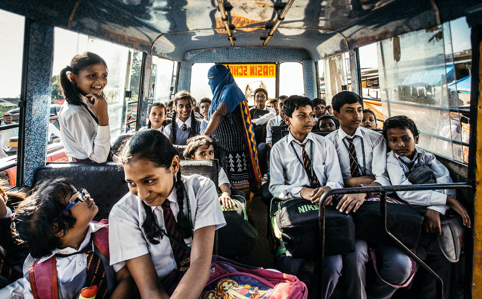 Selective Focus Photography of Child on Bus