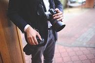 man, hands, camera