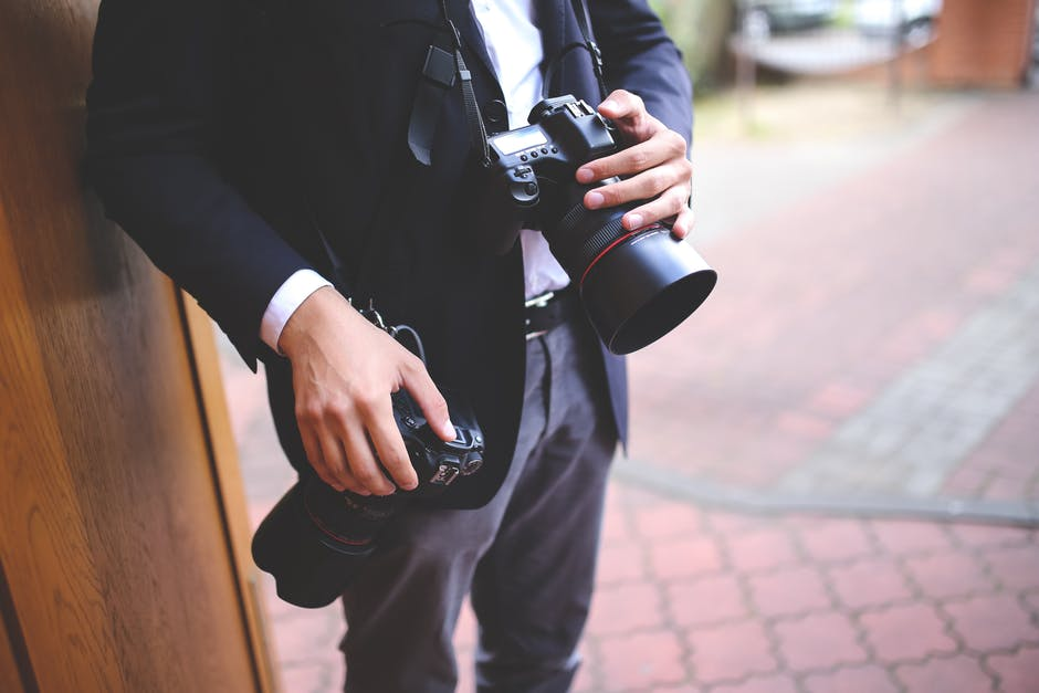 Photographer with two cameras