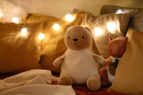 White Snowman Figurine Beside Lighted Candles