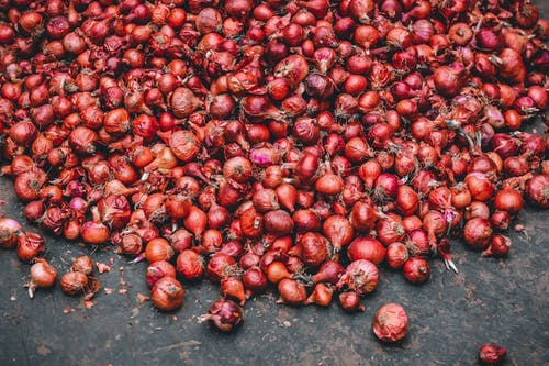 Red Onions on a Wooden Floor