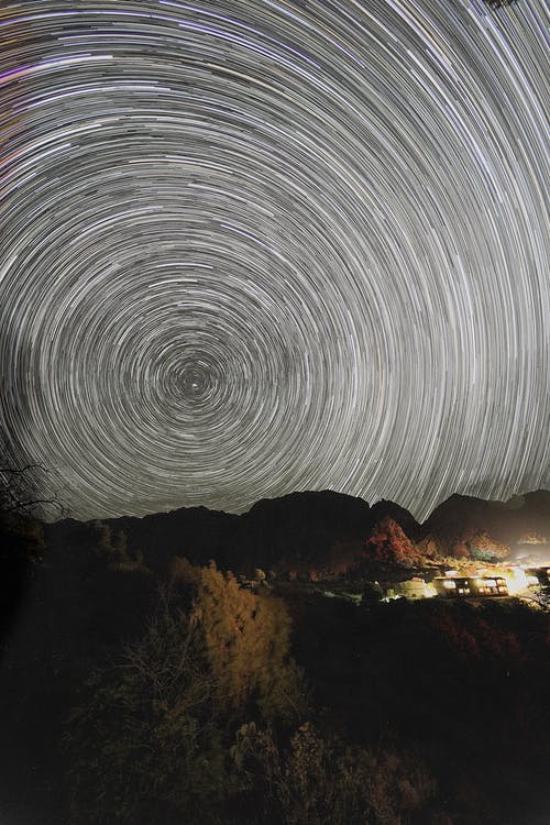 Photo of Star Trails Over a Mountain Landscape