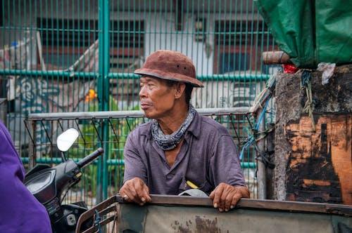 Senior ethnic man looking away on street