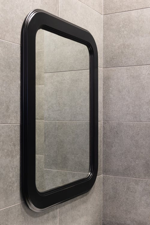 Mirror on wall in light bathroom