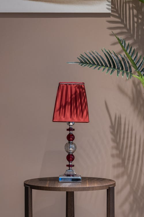 Lamp placed on table in light room