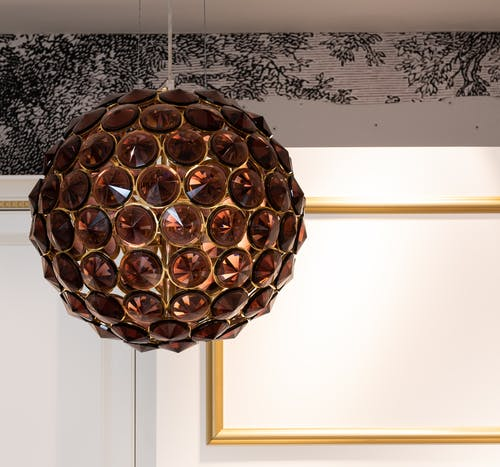 Room with creative lamp on ceiling