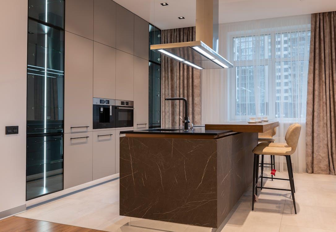 Interior of modern kitchen with furniture in daytime