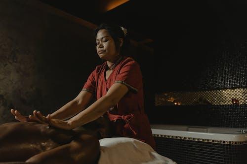 A Masseuse Doing a Massage