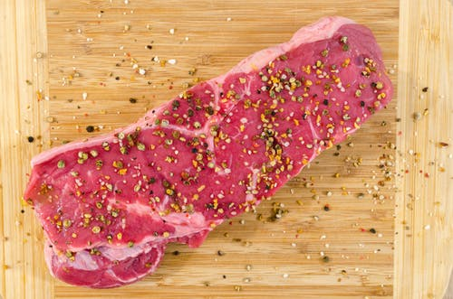 Raw Meat on Beige Wooden Surface