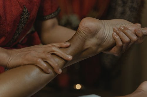 Close-Up Shot of a Person Doing a Massage on a Foot