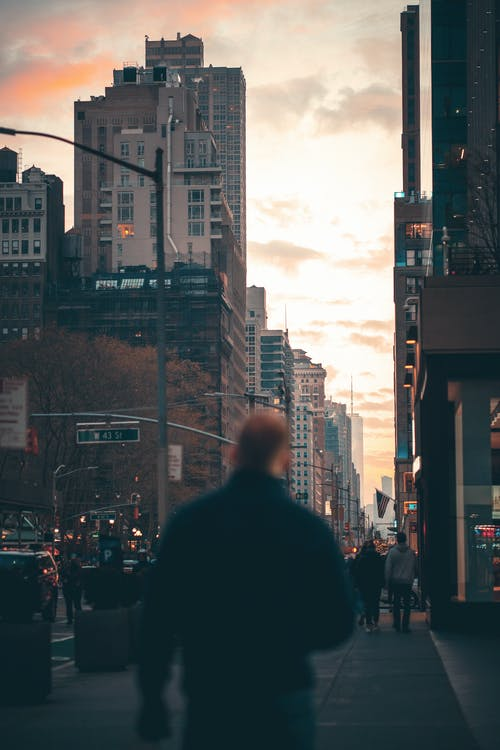 Man in Black Jacket Standing on the Street