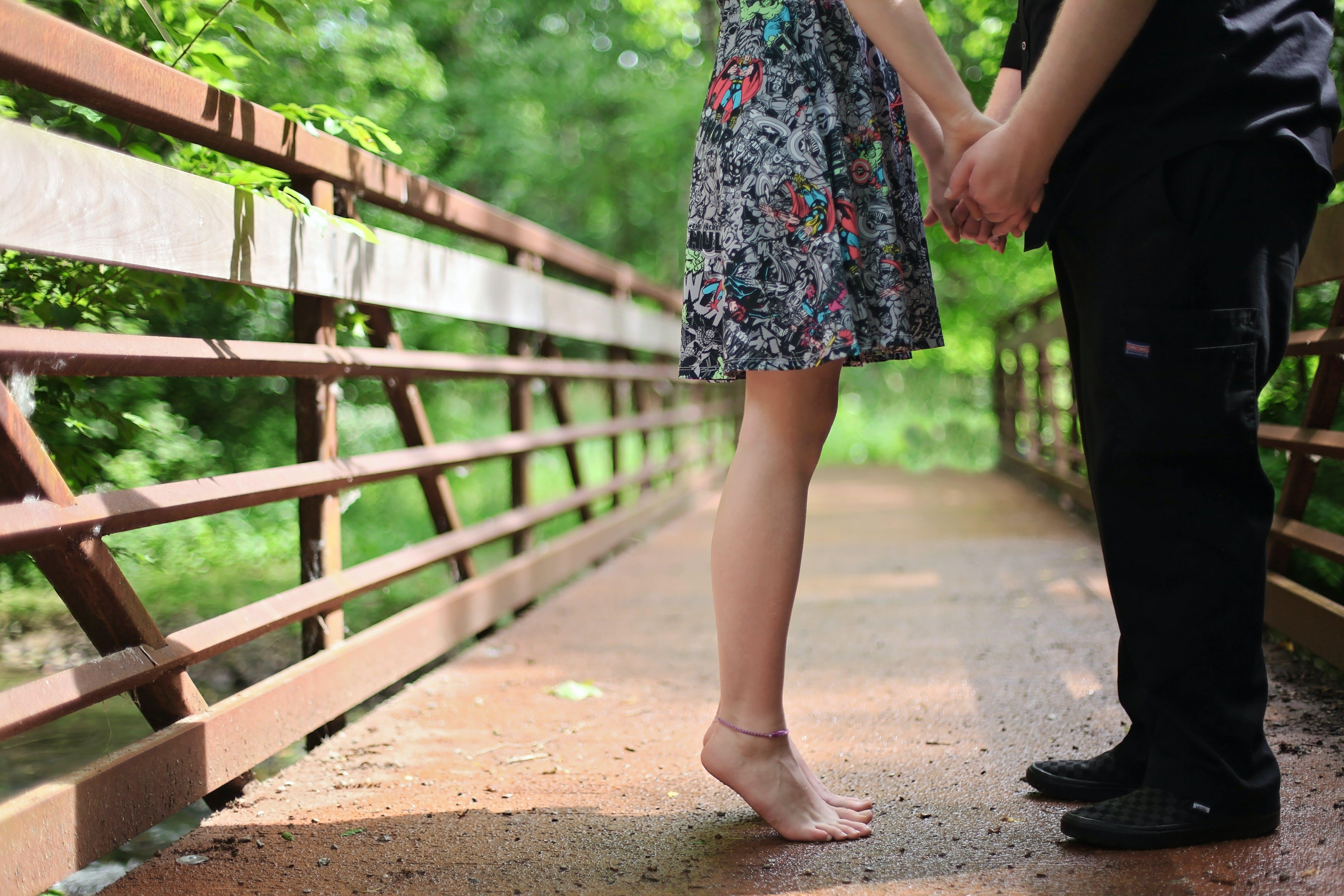 Couple Standing on Bridge