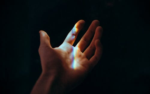 Persons Left Hand With Blue Light