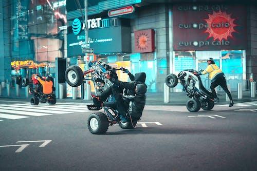 Man in Black Jacket Riding Black Motorcycle
