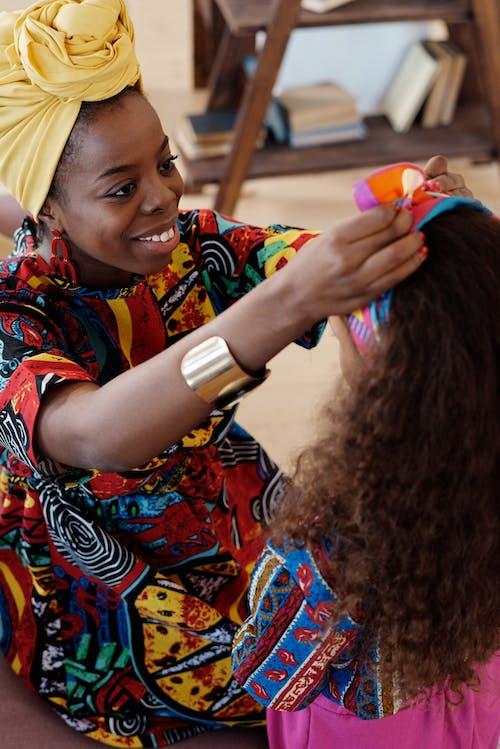 Photo Of Woman Fixing Girl's Headband