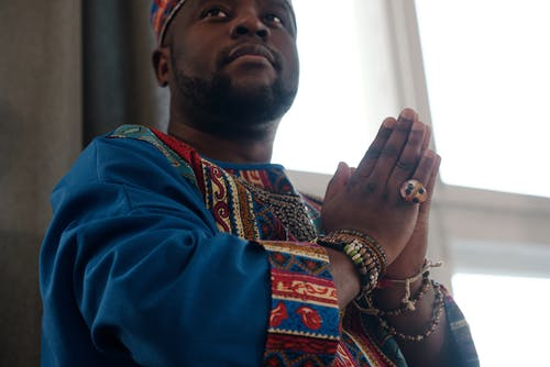 Close-Up Photo Of Man With Praying Hands