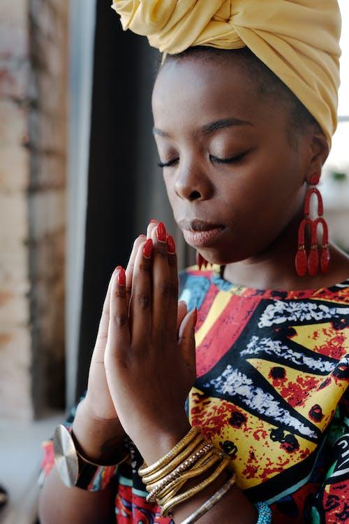 Close-Up Photo Of Woman Praying