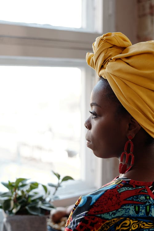 Photo Of Woman Looking Through Window