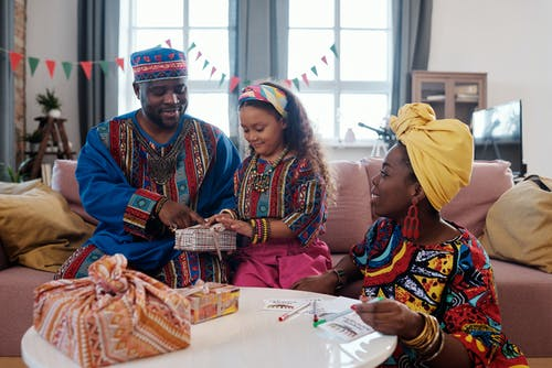 Photo Of Family Wrapping Gifts