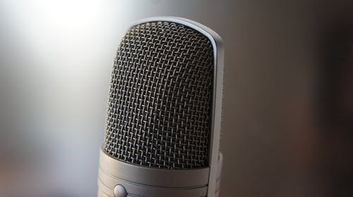 White and Black Microphone on White Table