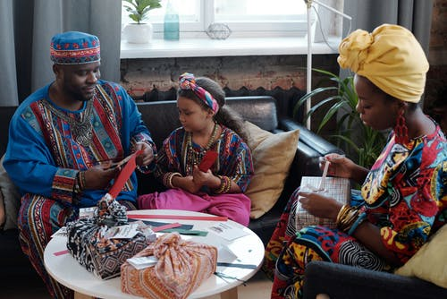 Photo Of Family Preparing Gifts