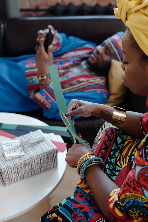Photo Of Woman Cuts Through Craft Paper