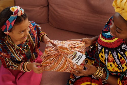 Photo Of Child Happily Receives A Gift