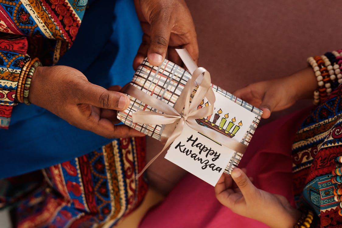 Photo Of People Giving Each Other Gifts