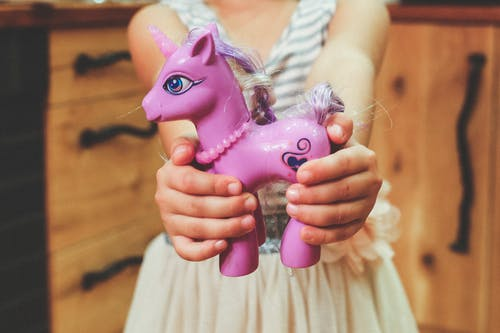Child holding unicorn toy