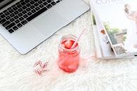 magazines, laptop, drink