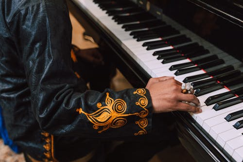 Photo Of Person Playing Piano