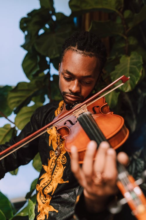 Close-Up Photo Of Man Playing Violin