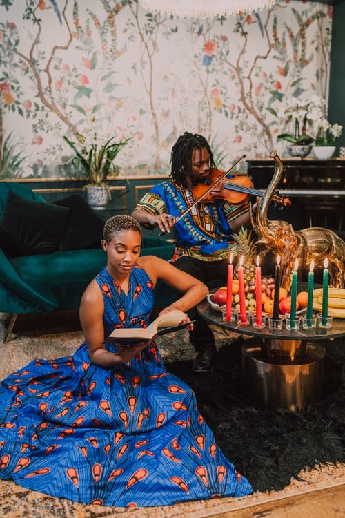 Man And Woman In Blue Kaftan And Dashiki Clothes