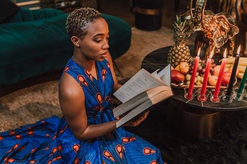 Woman in Blue Kaftan Dress Reading Book