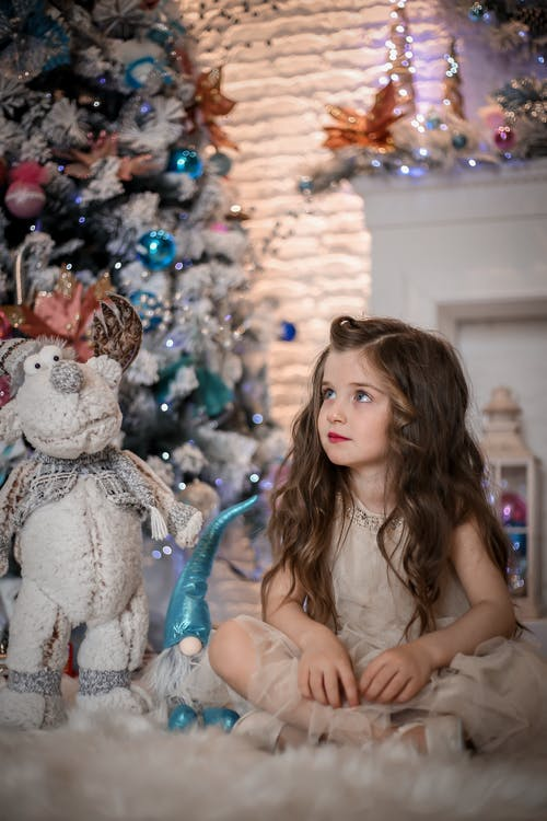 Dreamy girl in living room decorated for Christmas