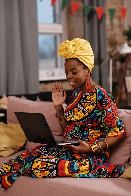 Photo Of Woman Waving On Her Laptop