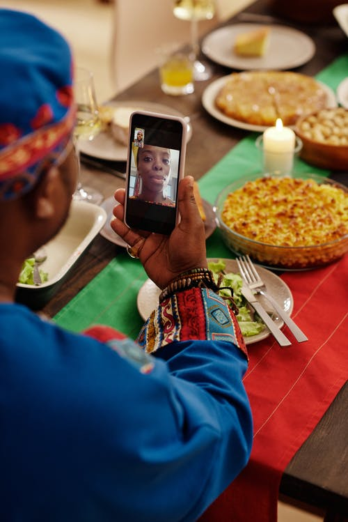Photo Of Person Having A Video Call Through His Smartphone