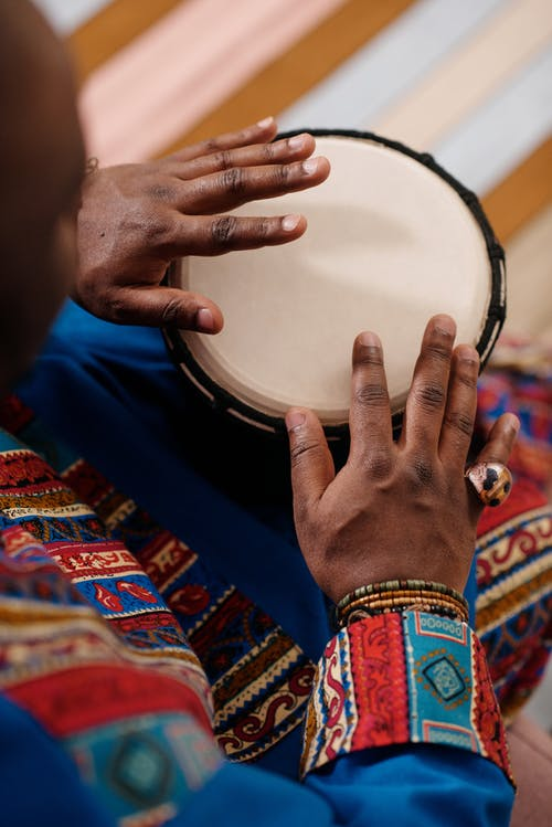 Photo Of Person Playing Djembe