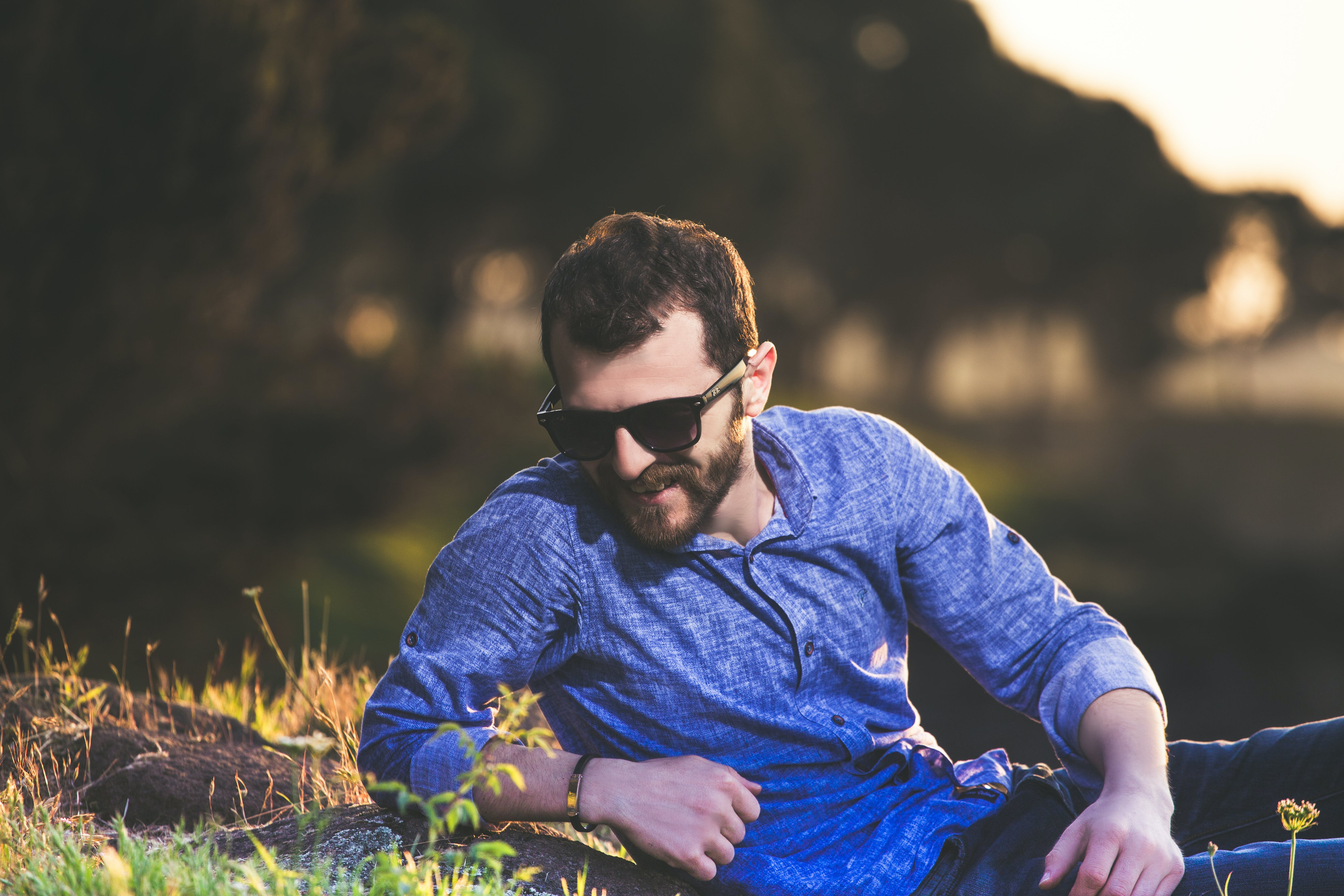 Selective Focus Photography of Man Lying on Green Grass