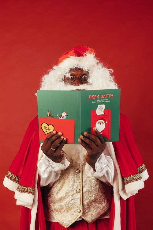 A Christmas Card Covering a Santa Claus' Face
