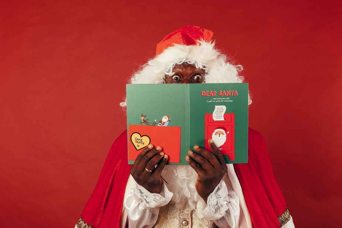 A Christmas Card Covering a Santa Claus' Face